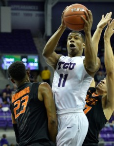 Guard Brandon Parrish knives through Oklahoma State's Leyton Hammonds and Jeffrey Carroll in TCU's 63-56 win. Parrish led the Frogs in scoring with 15 points. Photo Courtesy/gofrogs.com