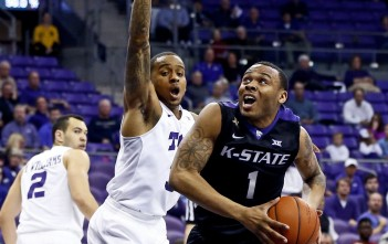 Malique Trent tries to stop K-State's Carlbe Ervin II in TCU's 63-49 loss. Photo Courtesy/ USA Today Sports